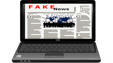 Image of a laptop screen displaying 'fake news' page