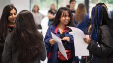 An image of students at Ark Academy in Wembley receiving their 2018 A-level results
