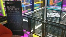 A close up image of furniture and a sign displaying 'Data science campus'