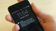 A message from HM Passport Office sent via GOV.UK Notify appears on a smartphone screen