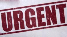 A close-up image of red 'URGENT' lettering on the front of a letter