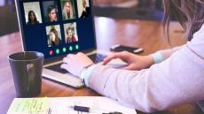 A close-up image of a video call taking place on the laptop scheme of someone who is working from home
