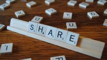 Image of  Scrabble tiles spelling out 'Share'