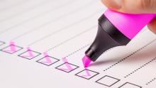 An image of a checklist with items being ticked off by a pink highlighter pen