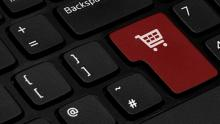 An image of a shopping trolley pictured on the enter key of a computer keyboard
