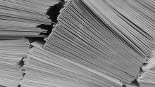 A close-up image of piles of paper