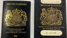 An image of a 2020-style blue British passport, next to an older version