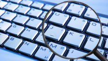 Image of a magnifying glass on keyboard