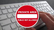 Image of a privacy sign over a computer