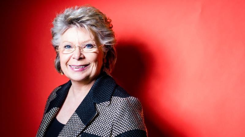 Viviane Reding against a red background