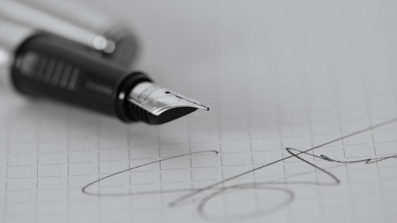 Pen signing a form