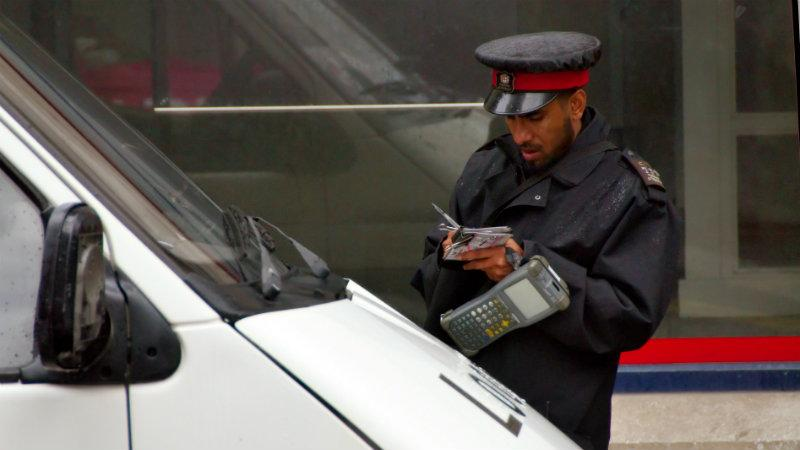 Traffic warden issues a parking ticket