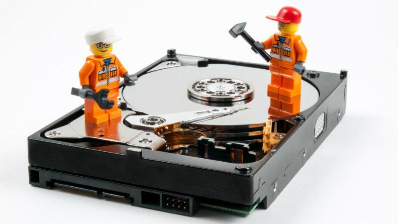 Lego men repairing a CD drive