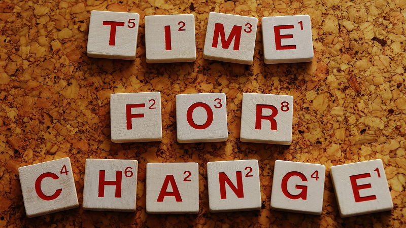 An image of tiles spelling out 'time for change'