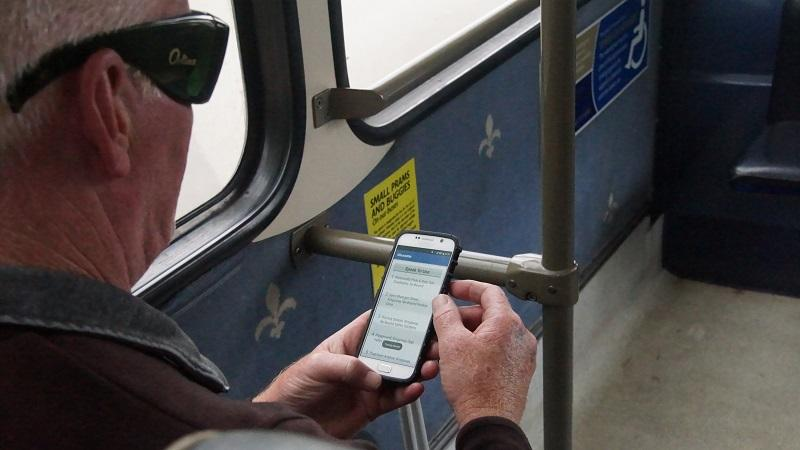 Image of a visually impaired passenger using the Glos Talk app