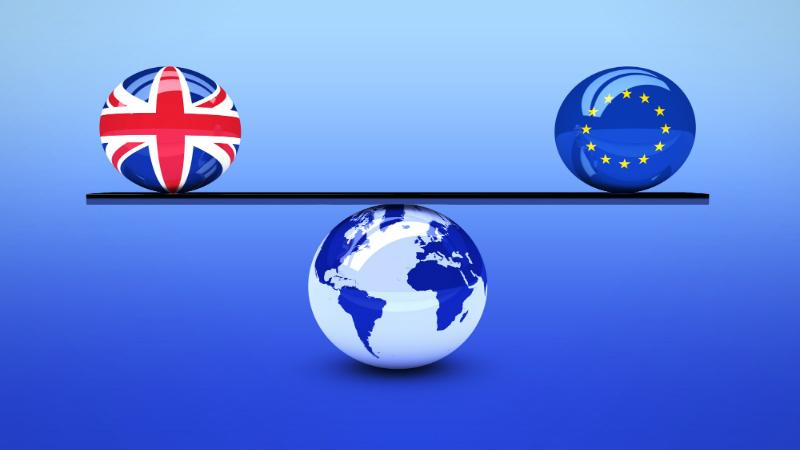 a globe with scales balancing the EU and Union Jack flags