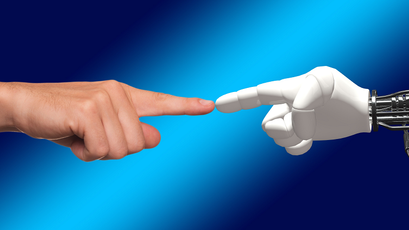 An image of a human and a robot touching fingers