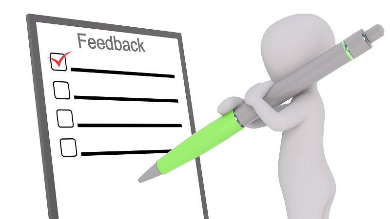 Image Of An Illustrated Person Filling Out A Feedback Form