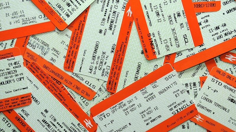 An image of many paper train tickets