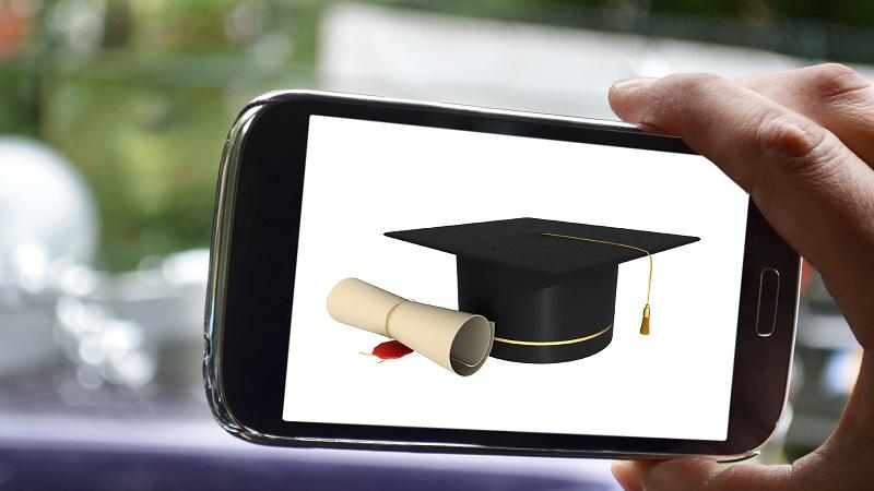 Image of a degree certificate and a mortar board on a smartphone