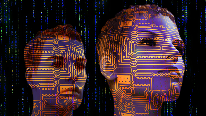 Image of two faces with circuits superimposed