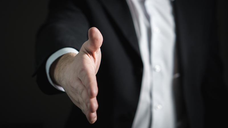 An image of a man offering a handshake