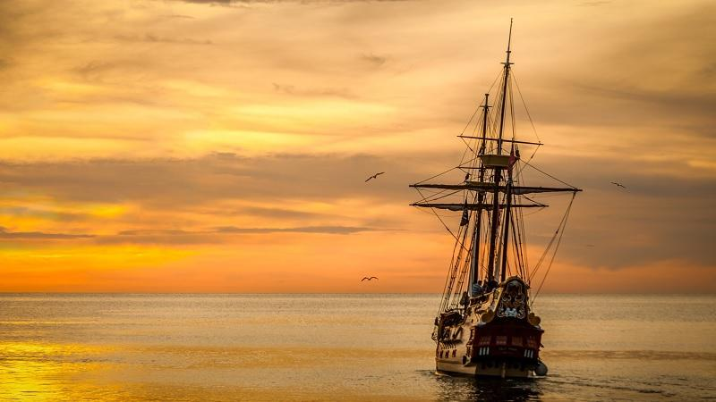 Image of a ship on the ocean at sunset