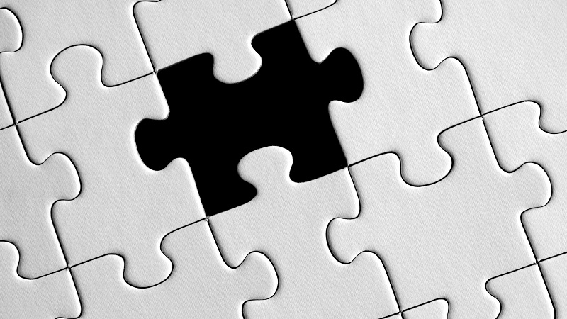 Image of a puzzle with one piece missing