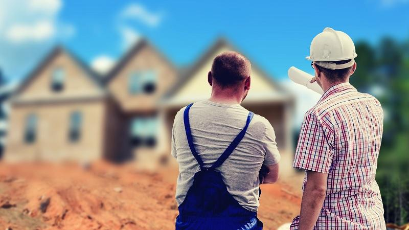 An image of two builders discussing an ongoing building project