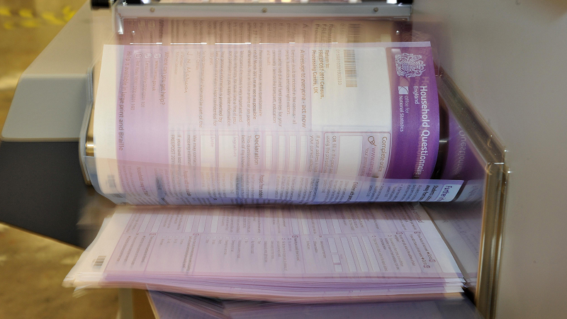 Image of test copies of the 2011 census being scanned