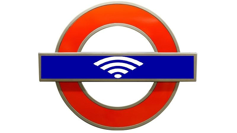 An image of a London underground sign with a wifi logo where the name of the station would usually be