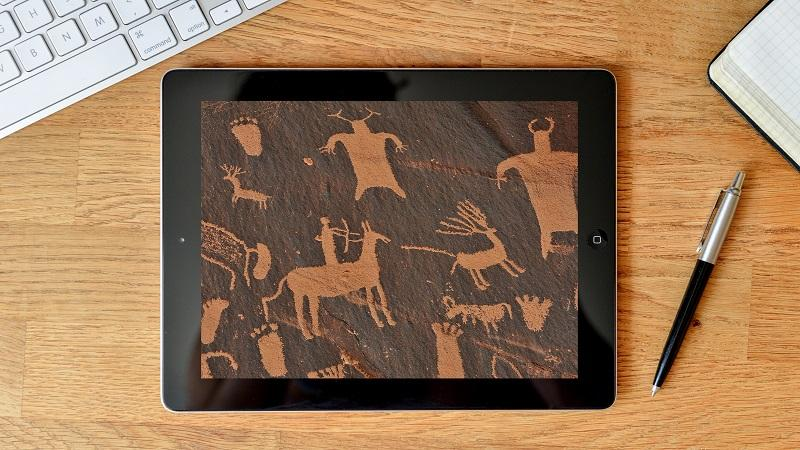 Image of cave painting murals on a tablet screen