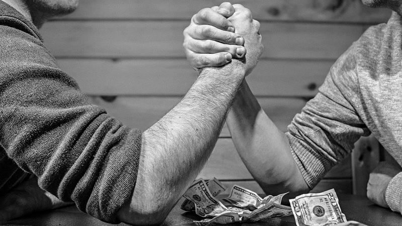Image of two men arm wrestling