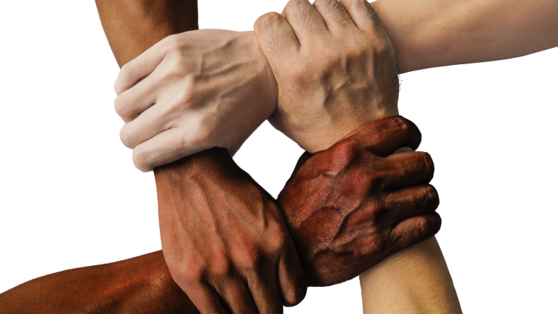 Image of four hands clasped together