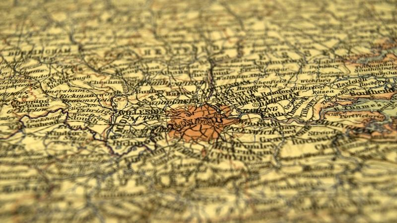 A close-up image of a map of London on yellow paper
