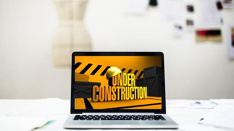 An image of a laptop screen displaying a message saying 'Under construction'