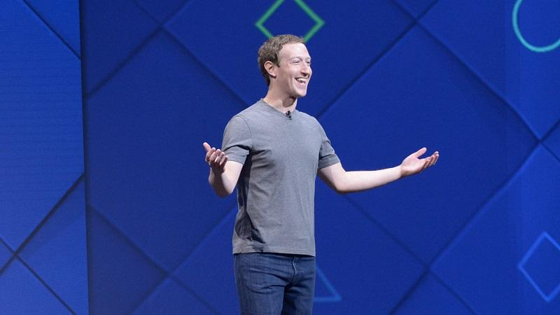 An image of Mark Zuckerberg speaking on a conference stage