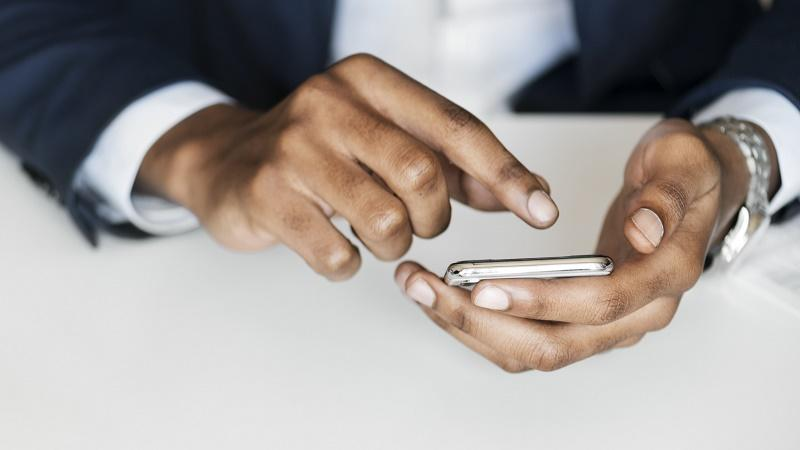 Image of a man using a mobile phone