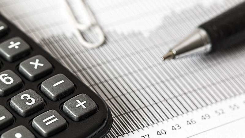 An image of a calculator and pen