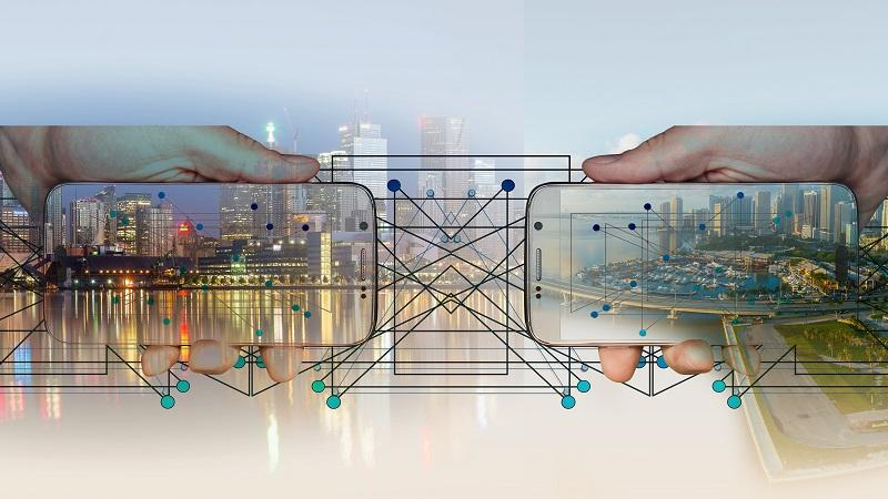 An image of urban landscapes with an overlay of an illustration of a network and two smartphone screens