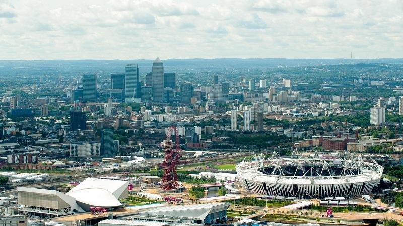 Aerial view of Londond Olympic Park with the Canary Wharf area in the background