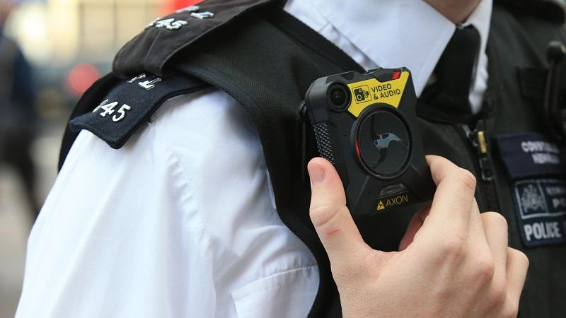 An image of a police officer using a body-worn camera