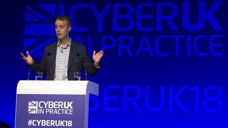 Image of  Dave Hogue of the NSA speaking at the CyberUK event