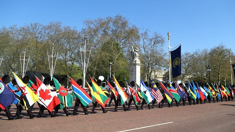 An image of British soldiers carrying Commonwealth flags down the Mall ahead of the Commonwealth Heads of Government Meeting 2018