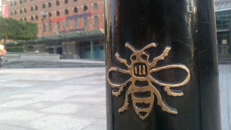 A close-up image of the Manchester bee symbol on a piece of the city's street furniture