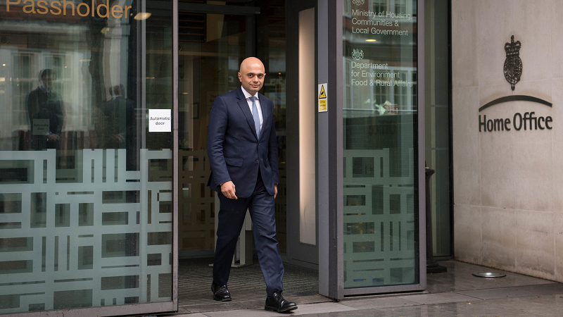 Sajid Javid walking out of the Home Office