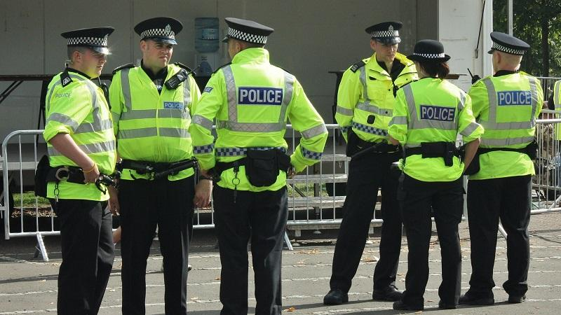 An image of a number of police officers standing in a group