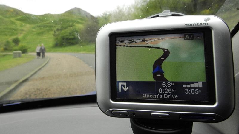Image of a TomTom satnav device in use on a car dashboard
