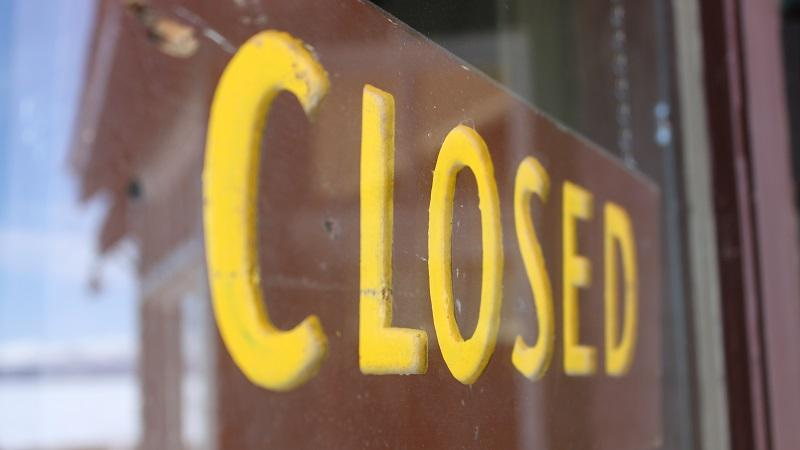 Image of a 'closed' sign in a shop window