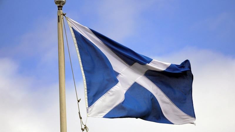 An image of a Scottish flag fluttering in light wind